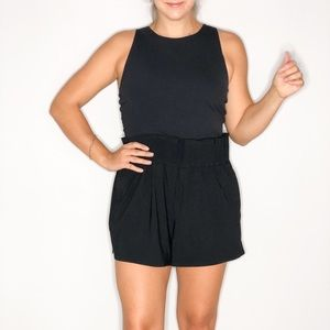 ATHLETA COSMIC FLUTTER ROMPER IN BLACK